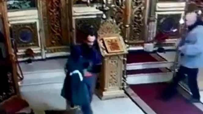 Biserica Sf. Ciprian din Bucureşti, prădată de hoţi. VIDEO cu momentul în care bărbatul ia cutia milei