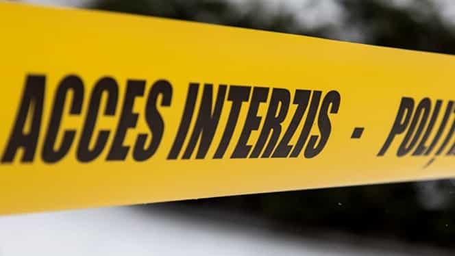 Caz şocant la Arad! Poliţist tăiat cu o macetă în faţa unui club