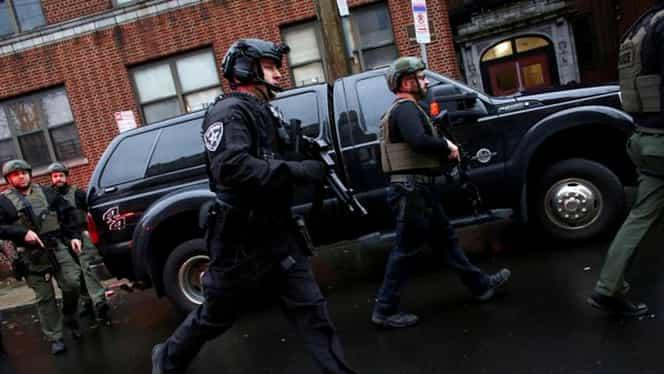Clipe de panică în Jersey City! Polițist, împușcat de doi indivizi înainte ca trupele SWAT să-i ucidă. Un martor a filmat totul. Video cu puternic impact emoțional