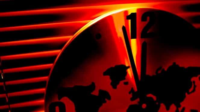 """""""Ceasul Apocalipsei"""" nu a fost niciodată mai aproape de miezul nopții! Oamenii de știință, avertizare teribilă pentru politicieni"""