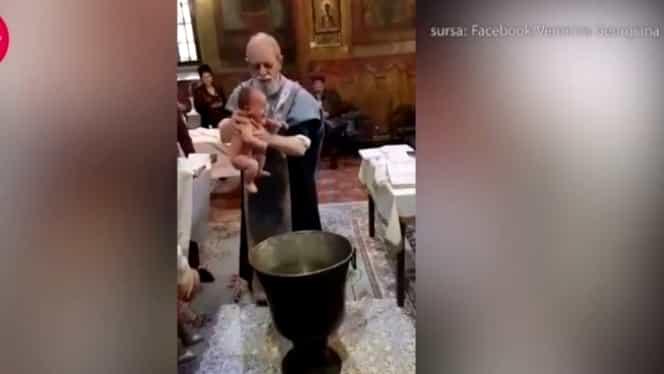 Preotul care a bruscat un bebeluş în timpul botezului a fost suspendat pentru 30 de zile