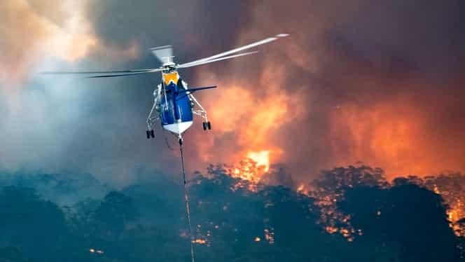 SOS Australia! Ordin de evacuare pentru mai multe oraşe. Elicopterele militare salvează oameni din foc