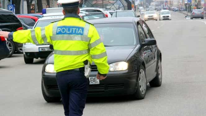 Polițist filmat în timp ce bate un șofer din Ștefănești! Video!