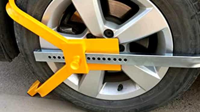 Atenție, șoferi! Blocarea roților mașinilor în parcările hipermarketurilor, declarată ilegală