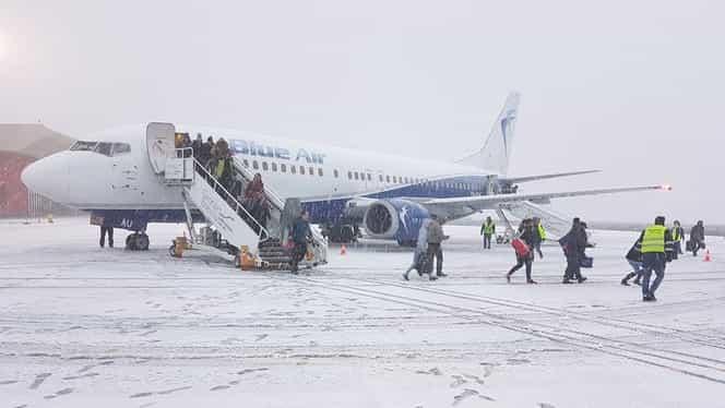 Întârzieri pe Aeroportul Henri Coandă, din cauza zăpezii