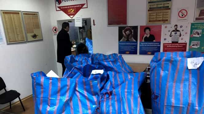 Poşta Română îngropată de coletele eMAG de Black Friday
