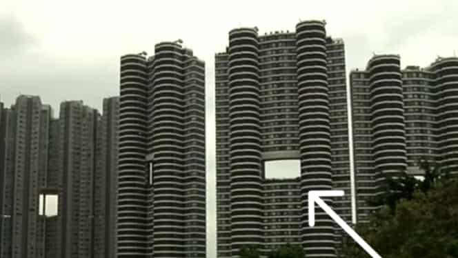Motivul halucinant pentru care zgârie norii din Hong Kong au găuri imense lăsate de constructori!