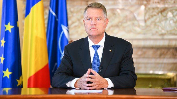Klaus Iohannis, preşedintele României în timpul unei şedinţe foto
