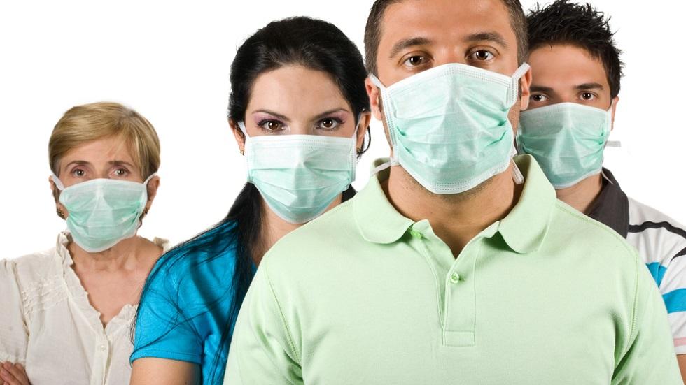 Măsuri împotriva gripei. E bine sau nu să folosim masca pe stradă?