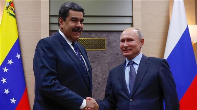 Vladimir Putin îl susține pe Nicolas Maduro