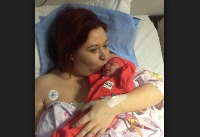Oana Roman în 2014, după operația de cezariană